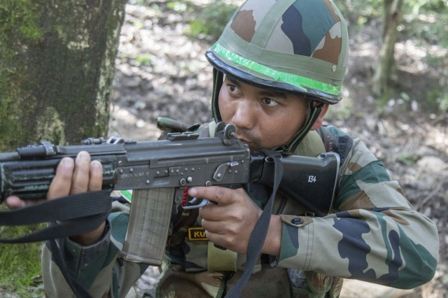 A Soldier with Indian army's 99th Mountain Brigade pulls security during an IED training lane Sept. 21, 2018, at Chaubattia Military Station, India. This was part of Yudh Abhyas, an exercise that enhances the joint capabilities of both the U.S. and Indian army through training and cultural exchange, and helps foster enduring partnerships in the Indo-Asia Pacific region. (U.S. Army photo by Staff Sgt. Samuel Northrup)