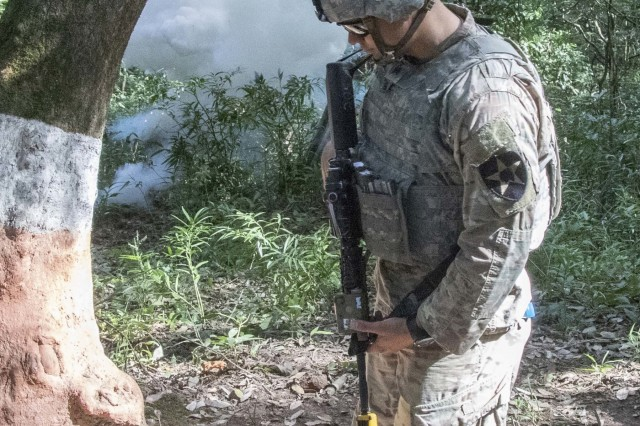 A simulated IED goes off as a Soldier with U.S. Army's 1st Battalion, 23rd Infantry Regiment, moves through an IED training lane Sept. 21, 2018, at Chaubattia Military Station, India. This was part of Yudh Abhyas, an exercise that enhances the joint capabilities of both the U.S. and Indian army through training and cultural exchange, and helps foster enduring partnerships in the Indo-Asia Pacific region. (U.S. Army photo by Staff Sgt. Samuel Northrup)