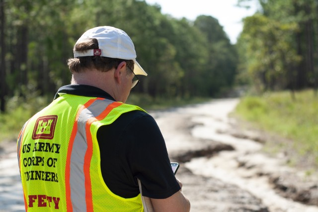 Ben Jones, Savannah District Architect, documents a road washout on Military Ocean Terminal Sunny Point, an Army installation in North Carolina impacted by Hurricane Florence. The Corps' battle-tested mission command brings to bear the full spectrum of contingency response under authorities given directly to USACE by Congress and as part of the federal response led by FEMA.