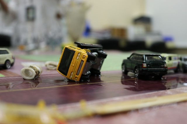 Toy cars and trucks simulate a chemical spill in a tabletop display to help train first responders to assess the emergency and formulate a response. The training is a component of the Toxic Chemical Training Course hosted by the U.S. Army Chemical Materials Activity and the Program Executive Office, Assembled Chemical Weapons Alternative at Aberdeen Proving Ground, Maryland, Aug. 27-31. Participants are medical first responders serving the communities surrounding the Army's two remaining chemical weapons stockpile sites: Pueblo Chemical Depot, Colorado, and Blue Grass Chemical Activity, Kentucky. (Photo: Jessica Tayson, U.S. Army Chemical Materials Activity Public Affairs Office)