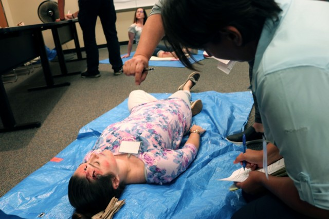 "Medical first responders triage ""victims"" in a mock chemical accident during the U.S. Army Public Health Center's Toxic Chemical Training Course, hosted by the U.S. Army Chemical Materials Activity and the Program Executive Office, Assembled Chemical Weapons Alternative at Aberdeen Proving Ground, Maryland, Aug. 27-31. The training participants are nurses, doctors and paramedics from the communities surrounding the two remaining Army chemical weapons stockpile sites: Pueblo Chemical Depot, Colorado, and Blue Grass Chemical Activity, Kentucky. (Photo: Jessica Tayson, U.S. Army Chemical Materials Activity Public Affairs Office)"