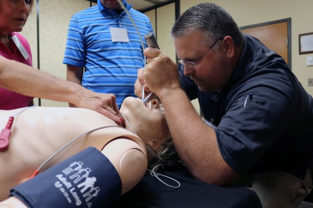 "Medical first responders ""treat"" a mannequin that can be programmed to respond to a variety of medical treatments, including toxic chemical decontamination. The U.S. Army Chemical Materials Activity and the Program Executive Office, Assembled Chemical Weapons Alternative hosted a Toxic Chemical Training Course at Aberdeen Proving Ground, Maryland, Aug. 27-31. Training participants are doctors, nurses and paramedics from the communities surrounding the two remaining Army chemical weapons stockpile sites, Pueblo Chemical Depot, Colorado, and Blue Grass Chemical Activity, Kentucky. (Photo: Jessica Tayson, U.S. Army Chemical Materials Activity Public Affairs Office)"