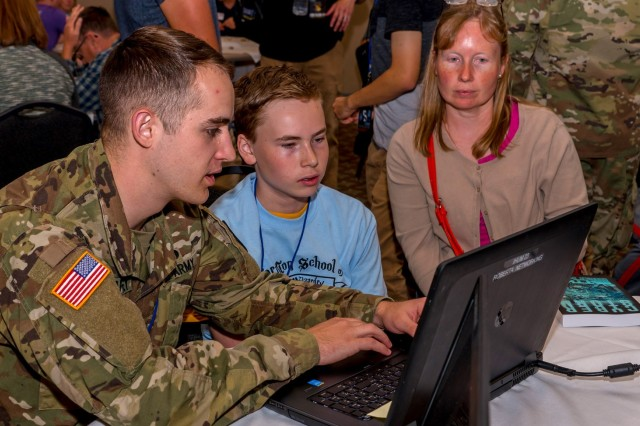 2nd Lt. Ken McGaffey provides tips for saving time writing linux commands for cyber operations during the CornCon IV, September 6-8 at St. Ambrose University, Davenport, Iowa, to help raise security awareness in the community and introduce children and adults to cybersecurity as a career choice.