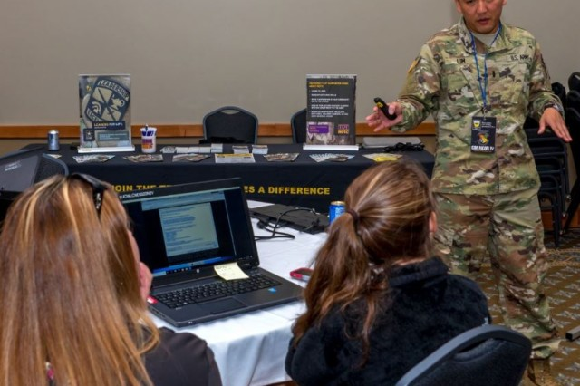 1st Lt. Daniel Lim explains how a defender would use a network traffic capture to determine how the attacker gained access to the web-server at CornCon IV, September 6-8 at St. Ambrose University, Davenport, Iowa, to help raise security awareness in the community and introduce children and adults to cybersecurity as a career choice.