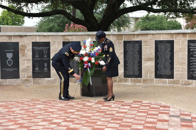 Brig. Gen. Darren Werner, commanding general of the 13th ESC, and Command Sgt. Maj. Cheryl N.M. Greene, command sergeant major of the 13th ESC, lay a wreath at the 13th ESC memorial honoring all Soldiers who have died while serving in the unit since 2001 during a memorial rededication ceremony on Sept. 21, 2018 at Fort Hood, Texas. The memorial rededication ceremony is the culminating event of the 13th ESC Birthday Week celebration. Photo by Sgt. 1st Class Michael Cox 13th ESC Public Affairs Office