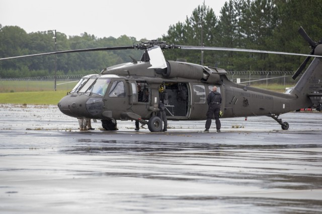 A UH-60 Black Hawk helicopter and its crew prepare for a mission at the North Carolina National Guard's Army Aviation Support Facility 1 in Morrisville, N.C. on Sept. 16, 2018.
