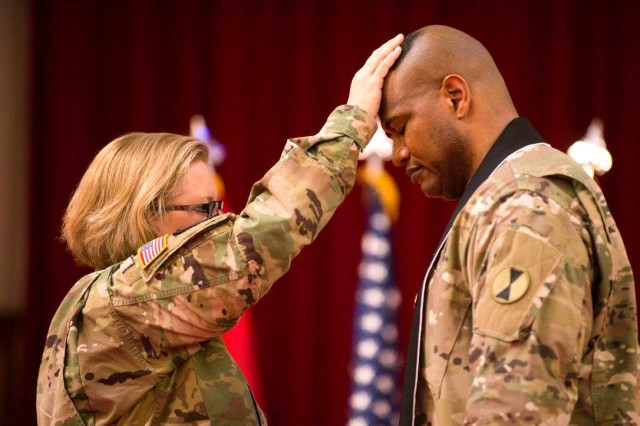 Lt. Col. Khallid Shabazz, right, participates in his Change of Stole ceremony inside the Lewis Main Chapel at Joint Base Lewis-McChord, Wash., May 23, 2017. Shabazz became the chaplain for the 7th Infantry Division during the ceremony, making him the Army's first Islamic chaplain at the division level. Shabazz is soon expected to be promoted to colonel, which would be the highest rank ever attained by any Muslim chaplain in the U.S. military.