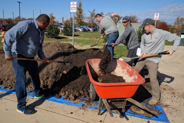 (Left to Right) Kelvin Herring, Andrew Nimitz, Tyrone Cook and Trey Lewis of Army Reserve Sustainability Programs build beds for the pollinator gardens at the Office of the Chief of Army Reserve (OCAR) at Fort Belvoir, VA in 2017. Photo by Jonelle Kimbrough, Army Reserve Sustainability Programs.