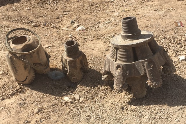 An assortment of the well drilling heads used in accomplishing the depth.
