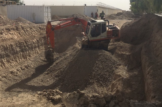 Contractors excavating a new sewage Lift Station for the Kandahar Air Wing Waste & Water treatment project.