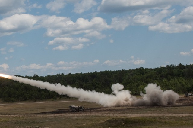 Gun crews of Battery B, 1st Battalion, 147th Field Artillery Regiment, Yankton, S.D., fire their Multiple Launch Rocket System at Camp Grayling, Mich., Aug. 10, 2018.