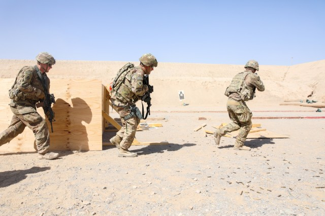 KANDAHAR AIRFIELD, Afghanistan (Sept. 13, 2018) -- Soldiers from Alpha Company, 1st Battalion, 12th Infantry Regiment, 2nd Infantry Brigade Combat Team, 4th Infantry Division and an advisor assigned to the 40th Infantry Division, California National Guard engage a target, Sept. 13, 2018, a Guardian Angel Live Fire Exercise at a range on Kandahar Airfield, Afghanistan. Soldiers from Company A serve as guardian angels for advisors assigned to Train, Advise and Assist Command-South who conduct routine advisory missions with Afghan National army and National Police members throughout Kandahar Province. (U.S. Army photo by Staff Sgt. Neysa Canfield/TAAC-South Public Affairs)