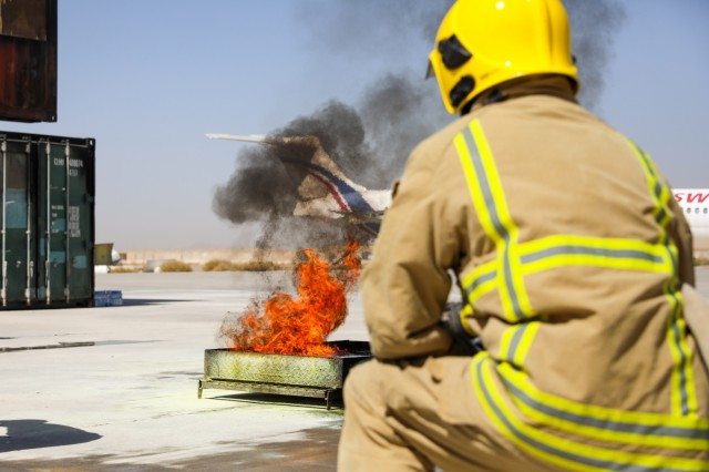 KANDAHAR AIRFIELD, Afghanistan (Sept. 18, 2018) -- A member of the Fire Department on Kandahar Airfield watches a controlled fire, Sept. 18, 2018, during fire training with Afghan National Police and Afghan National army members on the airfield in Kandahar, Afghanistan. Advisors from the 40th Infantry Division, California National Guard and 1st Security Force Assistance Brigade, under Train, Advise and Assist Command-South, planned the training fire training. (U.S. Army photo by Staff Sgt. Neysa Canfield/TAAC-South Public Affairs)