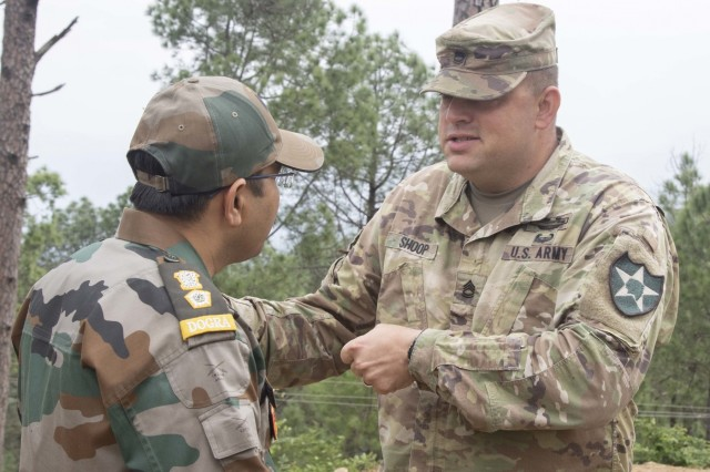 Sgt. 1st Class Michael Shoop, the 1-2 Stryker Brigade Combat Team Yudh Abhyas operations noncommissioned officer-in-charge, interacts with an Indian army officer Sept. 24, 2018, at Chaubattia Military Station, India. This was part of Exercise Yudh Abhyas 18, a bilateral training scenario designed to foster a shared tactical and technical understanding between the partnered military organizations. (U.S. Army photo by Staff Sgt. Samuel Northrup)