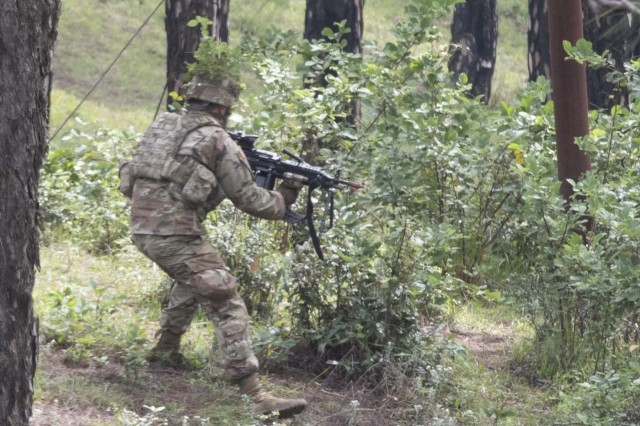 A Soldier with 1st Battalion, 23rd Infantry Regiment, advances toward a target during a move to contact demonstration Sept. 24, 2018, at Chaubattia Military Station, India. This was part of Exercise Yudh Abhyas 18, a bilateral training scenario designed to foster a shared tactical and technical understanding between the partnered military organizations. (U.S. Army photo by Staff Sgt. Samuel Northrup)