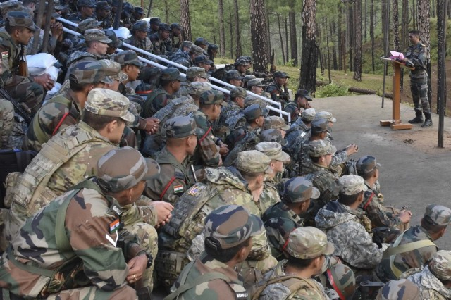 Soldiers with 1st Battalion, 23rd Infantry Regiment, and Indian army's 99th Mountain Brigade watch a lecture on the procedures of a search and destroy mission Sept. 24, 2018, at Chaubattia Military Station, India. This was part of Exercise Yudh Abhyas 18, a bilateral training scenario designed to foster a shared tactical and technical understanding between the partnered military organizations. (U.S. Army photo by Sgt. Jeff Hibbard)