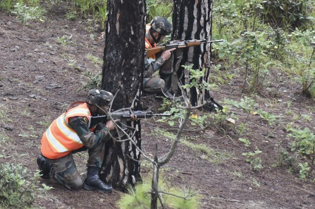 Indian army soldiers pull security during a search and destroy demonstration Sept. 24, 2018, at Chaubattia Military Station, India. This was part of Exercise Yudh Abhyas 18, a bilateral training scenario designed to foster a shared tactical and technical understanding between the partnered military organizations. (U.S. Army photo by Sgt. Jeff Hibbard)