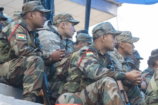 Soldiers with 1st Battalion, 23rd Infantry Regiment, and Indian army's 99th Mountain Brigade watch a lecture on the procedures of a search and destroy mission Sept. 24, 2018, at Chaubattia Military Station, India. This was part of Exercise Yudh Abhyas 18, a bilateral training scenario designed to foster a shared tactical and technical understanding between the partnered military organizations. (U.S. Army photo by Staff Sgt. Samuel Northrup)