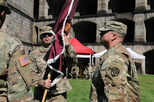 Col. Steven Gandia prepares to hand the flag back to his Command Sgt. Maj. Michael Carr. Northeast Medical Area Readiness Support Group holds a change of command, Sept. 16, 2018, at a ceremony at Fort Wadsworth Battery Weed on Staten Island, New York. The Change of Command ceremony symbolizes the continuation of leadership and unit identity despite the change of individual authority. It also represents the transfer of power from one leader to another; passing the ceremonial flag from outgoing to incoming commander is a physical representation of that transfer.