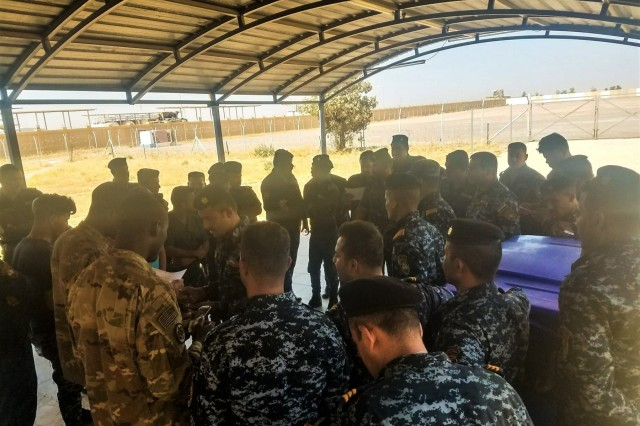 Spc. Willie Dunlap and Pfc. Kuadjo Johnson, medics with Steel Squadron, 3rd Cavalry Regiment, demonstrate hands on medical exercises with simulated injuries during first responder training in Iraq, Sep. 3, 2018. The Steel troopers from the Brave Rifles regiment are deployed to Iraq in support of Operation Inherent Resolve, working by, with and through the ISF and coalition partners from 74 nations to defeat ISIS in areas of Iraq and Syria, and to set conditions for follow-on operations to increase regional stability.