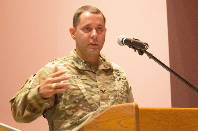 Col. Phillip K. Gage, commander of U.S. Army Garrison Japan, speaks at a town hall held Sept. 14 at Camp Zama's Community Recreation Center. The town hall was held to address lead-based paint in Army family housing following articles published in August that highlighted the issue.
