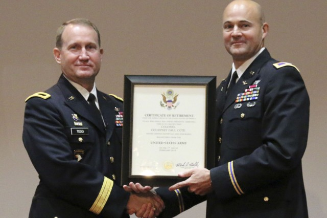 Col. Courtney Cote, right, accepts his certificate of retirement from Brig. Gen. Thomas Todd, program executive officer for aviation, Sept. 14 after more than 28 years in the Army. Cote also relinquished management of the Unmanned Aircraft Systems Project Office to Col. Scott Anderson.