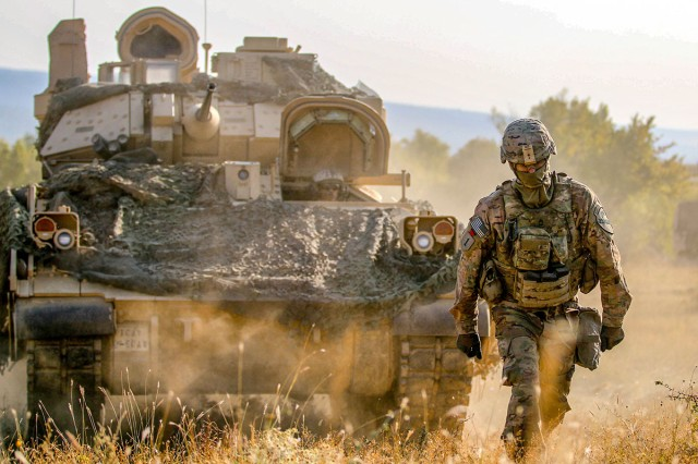 A Soldier guides a M2A3 Bradley Fighting Vehicle during an exercise at Novo Selo Training Area, Bulgaria, Aug. 23, 2018. The Next-Generation Combat Vehicle Cross-Functional Team is slated to release a request for proposal for the Optionally-Manned Fighting Vehicle on March 29, 2019. The OMFV is considered to be a replacement for the Army's aging Bradley Fighting Vehicle.