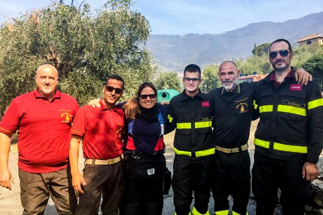 Camp Darby firefighters pose for a group photo with local fire officials.  The fire fighters supplied water to Italian firefighting vehicles capable of reaching fires in mountainous terrain during a major wildfire near Pisa, Sept. 25.  U.S. Army firefighters provided support with hundreds of Italian firefighters in combatting the wildfire that broke out in the hills above the city of Pisa during late evening, Sept. 24.