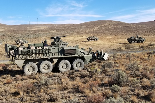 Soldiers from 2nd Battalion, 1st Infantry Regiment, and 14th Brigade Engineer Battalion, 2nd Stryker Brigade Combat Team, 2nd Infantry Division maneuver in A2 Strykers toward an objective during Stryker Engineering Change Proposal testing at Yakima Training Center, Wash. Sep, 19. ECP testing allows Soldiers to help the Army innovate and improve the Stryker's mobility performance, while maintaining its survivability by providing feedback in a realistic combat training environment.