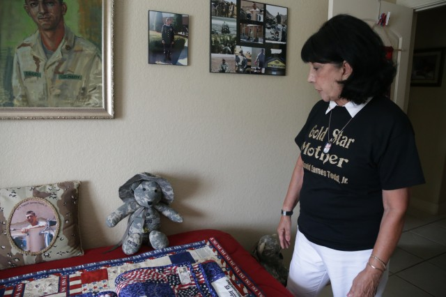 Mary Todd looks over the gifts given to her in honor of her late son.