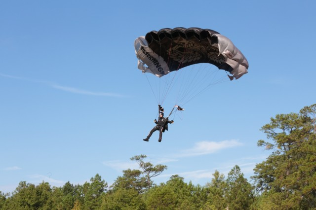 "FORT BENNING, Ga. (Sept. 27, 2018) - The Silver Wings of the 1st Battalion, 507th Parachute Infantry Regiment, parachute into a grand opening ceremony. The Faculty, staff, students and guests celebrated the grand opening of E. A. White Elementary School at its new location at Sand Hill at Fort Benning, Georgia, Sept. 26, 2018. The new facility serves the Families of military service members who live at Patton Village at Fort Benning. The school is 109,390 square feet and can hold up to 600 students from pre-kindergarten to fifth grade. In addition to having a learning garden, three outdoor amphitheaters, solar panels for hot water, a wind turbine, and an energy dashboard for monitoring utility use, the teaching areas are arranged by grades into ""neighborhoods,"" where the multiple classes within a grade share a space to learn collaboratively. (U.S. Army photos by Markeith Horace, Maneuver Center of Excellence, Fort Benning Public Affairs)"