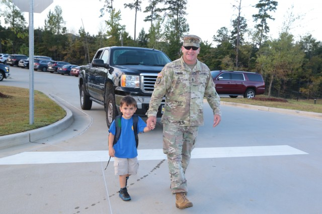 "FORT BENNING, Ga. (Sept. 27, 2018) - Faculty, staff, students and guests celebrated the grand opening of E. A. White Elementary School at its new location at Sand Hill at Fort Benning, Georgia, Sept. 26, 2018. The new facility serves the Families of military service members who live at Patton Village at Fort Benning. The school is 109,390 square feet and can hold up to 600 students from pre-kindergarten to fifth grade. In addition to having a learning garden, three outdoor amphitheaters, solar panels for hot water, a wind turbine, and an energy dashboard for monitoring utility use, the teaching areas are arranged by grades into ""neighborhoods,"" where the multiple classes within a grade share a space to learn collaboratively. (U.S. Army photos by Markeith Horace, Maneuver Center of Excellence, Fort Benning Public Affairs)"