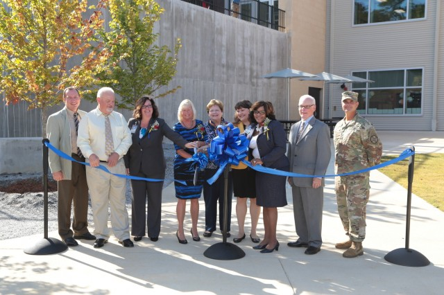 "FORT BENNING, Ga. (Sept. 27, 2018) - Department of Defense Education Activity (DoDEA) Americas and Army personnel cut the ribbon during the grand opening of E.A. White Elementary School. Faculty, staff, students and guests celebrated the grand opening of E. A. White Elementary School at its new location at Sand Hill at Fort Benning, Georgia, Sept. 26, 2018. The new facility serves the Families of military service members who live at Patton Village at Fort Benning. The school is 109,390 square feet and can hold up to 600 students from pre-kindergarten to fifth grade. In addition to having a learning garden, three outdoor amphitheaters, solar panels for hot water, a wind turbine, and an energy dashboard for monitoring utility use, the teaching areas are arranged by grades into ""neighborhoods,"" where the multiple classes within a grade share a space to learn collaboratively. (U.S. Army photos by Markeith Horace, Maneuver Center of Excellence, Fort Benning Public Affairs)"