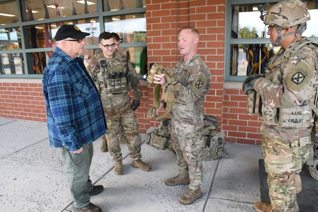 Soldiers from E Company, 1st Battalion, 32nd Infantry Regiment, 1st Brigade Combat Team, speaks with attendees outside the Post Exchange Sept. 22 during the 2018 Retiree Appreciation Day events at Fort Drum. (Photo by Mike Strasser, Fort Drum Garrison Public Affairs)