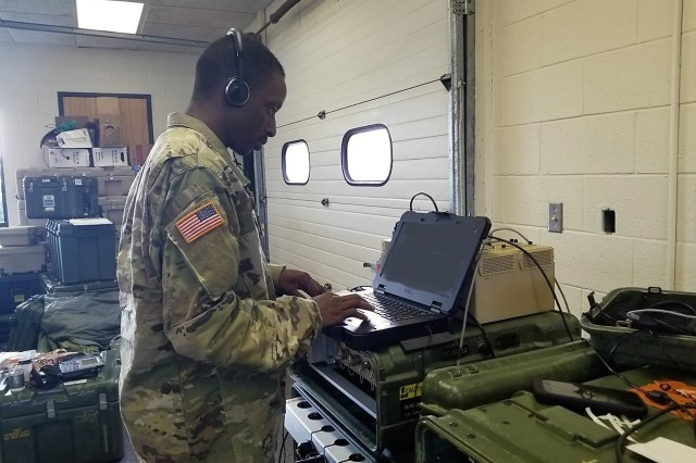 In the wake of Hurricane Florence, a Soldier from the North Carolina Army National Guard 113th Sustainment Brigade provides dispatch services for incoming calls using the unit's Disaster Incident Response Emergency Communications Terminal (DIRECT), in Kinston, N.C., Sept. 2018.