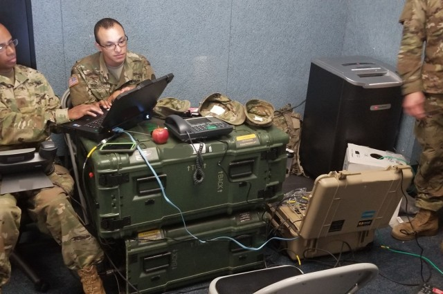 Soldiers from the North Carolina Army National Guard 295th Signal Network Support Company, 130th Maneuver Enhancement Brigade configure the Commercial Coalition Equipment, part of their Disaster Incident Response Emergency Communications Terminal (DIRECT) system. The unit used the system to support Columbus County Emergency Management 911 Dispatch in Whiteville, N.C., Sept. 2018.