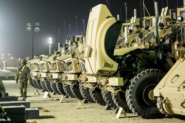 M-ATV Mine-Resistant Ambush Protected (MRAP) vehicles are staged for issue at an Army Prepositioned Stocks-5 remote lot, June 27, 2018 at Camp Arifjan, Kuwait. The vehicles are part of APS-5's ABCT equipment set. APS-5 is managed and maintained by the 401st Army Field Support Brigade. This equipment draw of APS-5's newly configured for combat ABCT marks the largest ever draw from APS-5.