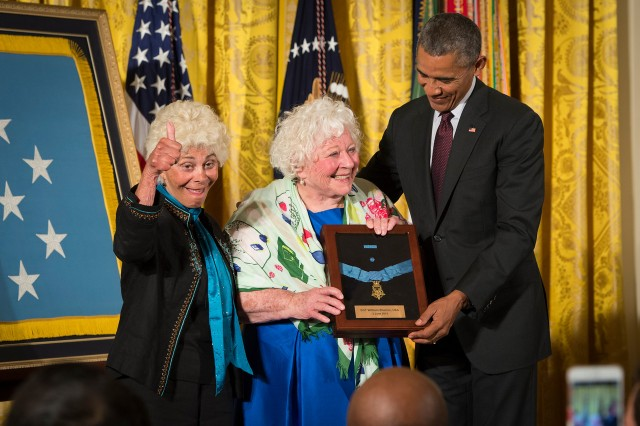 President Barack Obama bestows the Medal of Honor to Sgt. William Shemin. Accepting on his behalf are his daughters, Elsie Shemin-Roth (middle) and Ina Bass (left), in the East Room of the White House, June 2, 2015.