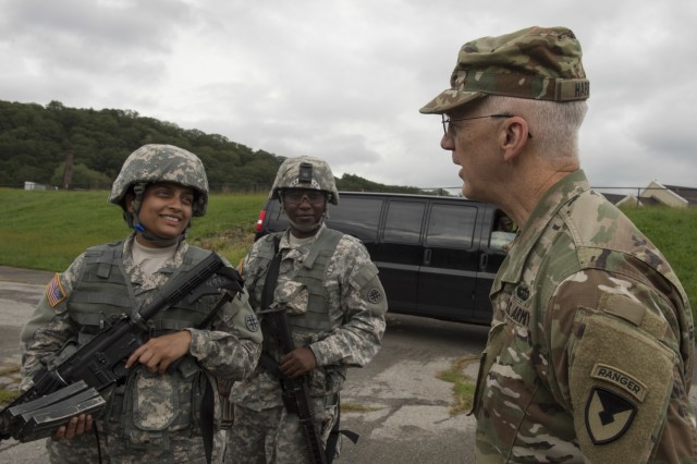 Spc. Rajani Medury, at left, and Spc. Crisple Wahome, both of the 103rd Quartermaster Company, talks with Maj. Gen. Allen Harrell, assistant deputy commanding general for National Guard Affairs, Army Materiel Command, about their weapons qualification at the Army National Guard New York Training Site at Camp Smith. Harrell visited the West Point LRC to observe reserve component support mission operations and meet with Reserve Soldiers during inventory and supply support operations at the U.S. Military Academy.(U.S. Army photo by Bryan Ilyankoff)