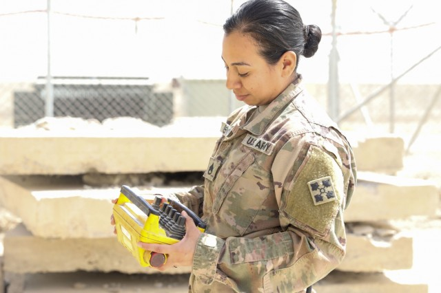 KANDAHAR AIRFIELD, Afghanistan (Sept. 15, 2018) --- U.S. Army Staff Sgt. Erica Robedo, a wheeled vehicle mechanic assigned to Company G, 1st Battalion, 12th Infantry Regiment, 2nd Infantry Brigade Combat Team, 4th Infantry Division, checks a piece of equipment, Sept. 15, 2018, while conducting preventive, maintenance and service checks for the company's recovery vehicles in Kandahar Airfield, Afghanistan. (U.S. Army photo by Staff Sgt. Neysa Canfield/2IBCT PAO)