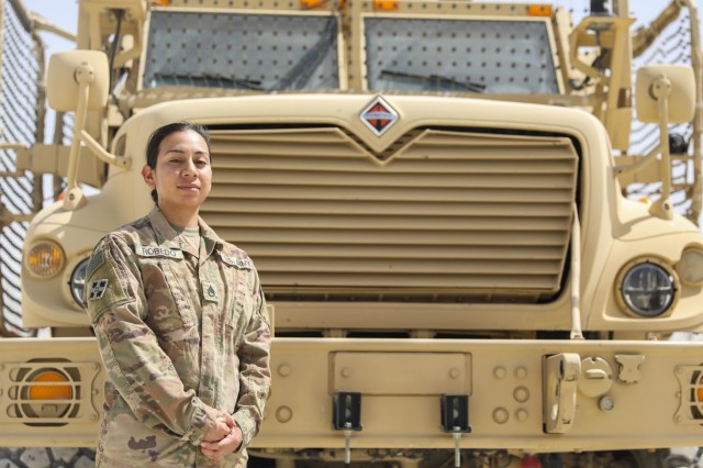 KANDAHAR AIRFIELD, Afghanistan (Sept. 15, 2018) --- U.S. Army Staff Sgt. Erica Robedo, a wheeled vehicle mechanic assigned to Company G, 1st Battalion, 12th Infantry Regiment, 2nd Infantry Brigade Combat Team, 4th Infantry Division, was motivated to enlist in the U.S. Army by her father who served in the Vietnam War. (U.S. Army photo by Staff Sgt. Neysa Canfield/2IBCT PAO)