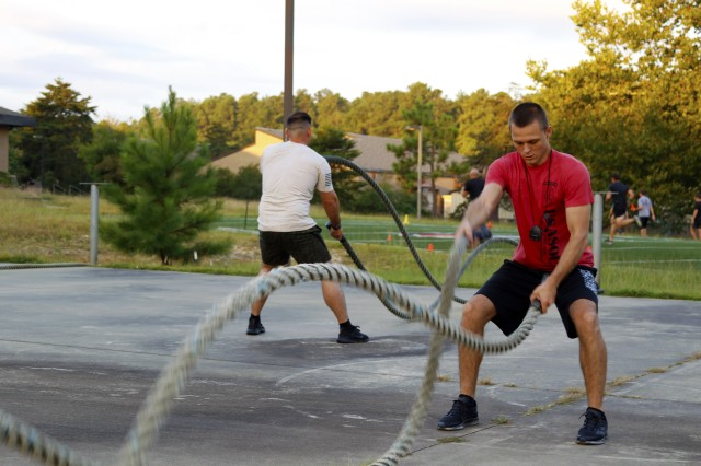 Members of U.S. Army Special Operations Command, Headquarters and Headquarters Company, participate in physical training dedicated to their fallen comrades.