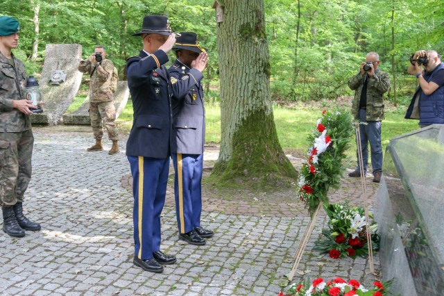 Lieutenant Colonel Matthew Dennis and Command Sgt. Maj. Jonathon Ballard, Commander and Command Sgt. Maj. respectively of 1 Battalion 82nd Field Artillery Regiment, 1st Armored Brigade Combat Team, 1st Cavalry Division render honors at the Barbaka Forest memorial site. This site remembers those whom were victims of NAZI atrocities and buried in mass graves in Barbarka forest in the Barbary sector of Torun, Poland during WWII. Annually, this memorial takes place to perhaps help survivors and relatives find some peace while vowing to never again allow such heinous acts as these to occur. Soldiers from 1-82 FA were the first American Soldiers to participate in this annual event.