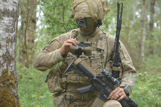 1st. Lt. Michael Austin, 173rd Airborne Brigade, uses the End User Device to report information to his company commander through the Integrated Tactical Network during a live-fire exercise in Germany.