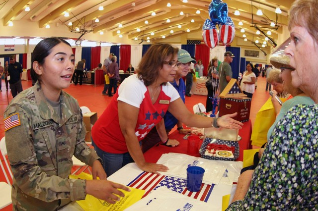 Volunteer Pvt. Jacqueline Maldonado, Maria Gomez, and retired Command Sgt. Maj. Jenny Clement welcome retirees to the open house Sept. 20, 2018, at Rinehart Fitness Center. Maldonado is a student in the Patriot missile course, Gomez is the Retirement Services Office application coordinator, and Clement is the treasurer for the Fort Sill Retiree Council.