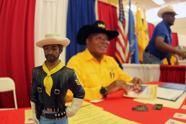 "A Buffalo Soldier statue sits on a table, while Trooper Don Mims talks with retirees. Several troopers were on hand to talk about the 9th and 10th (Horse) Cavalry ""Buffalo Soldiers"" Lawton-Fort Sill Chapter during the open house."
