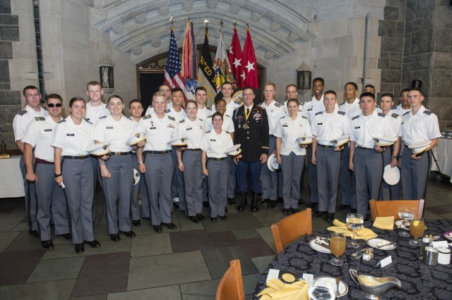 Cadets take a moment to pose for a photo with Lt. Col. Matthew Myer, a 2001 graduate and the 2018 Nininger Award recipient in the Cadet Mess Hall following a dinner in his honor Sept. 27, 2018. The Alexander R. Nininger Award for Valor at Arms is presented for personal bravery and leadership while leading soldiers in combat.