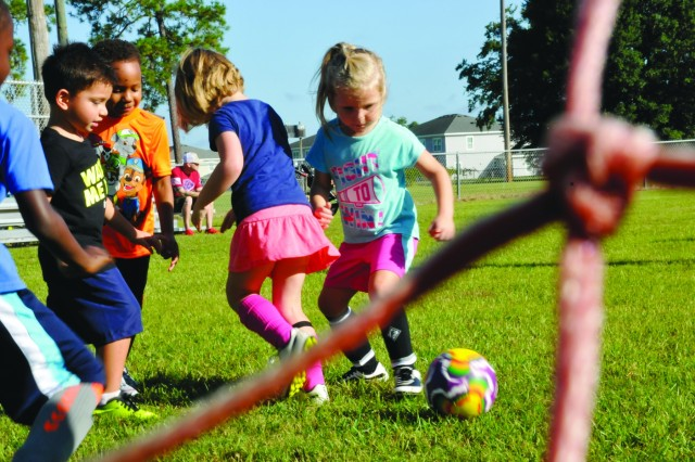 Aubree May, 4, drives the soccer ball toward the goal, Sept. 8 on Fort Stewart during the installation CYS beginner soccer. (U.S. Army photo by Sgt. Laurissa Hodges)