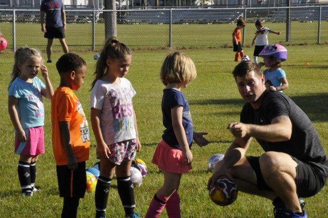 Coach Anthony Spadoni talks to children, Sept. 8, at Fort Stewart's Directorate of Family, Morale, Welfare and Recreation's beginner soccer at Greene Field, on Fort Stewart. MWR Child and Youth Services offers the program through the end of October. Games start the week of Sept. 24. (U.S. Army photo by Sgt. Laurissa Hodges)