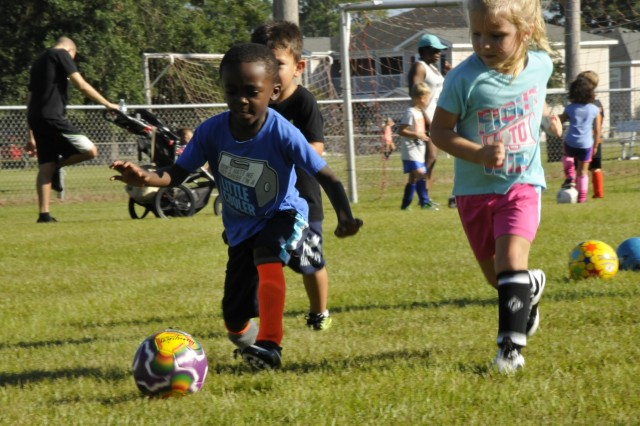 Terrance Williams, 4, runs the ball, Sept. 8. at Greene Field on Fort Stewart. (U.S. Army photo by Sgt. Laurissa Hodges).
